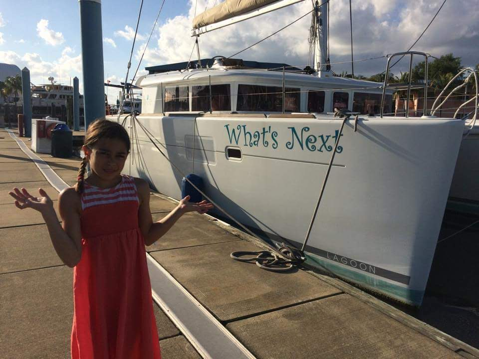 Ahava poses in front of s/v What's Next